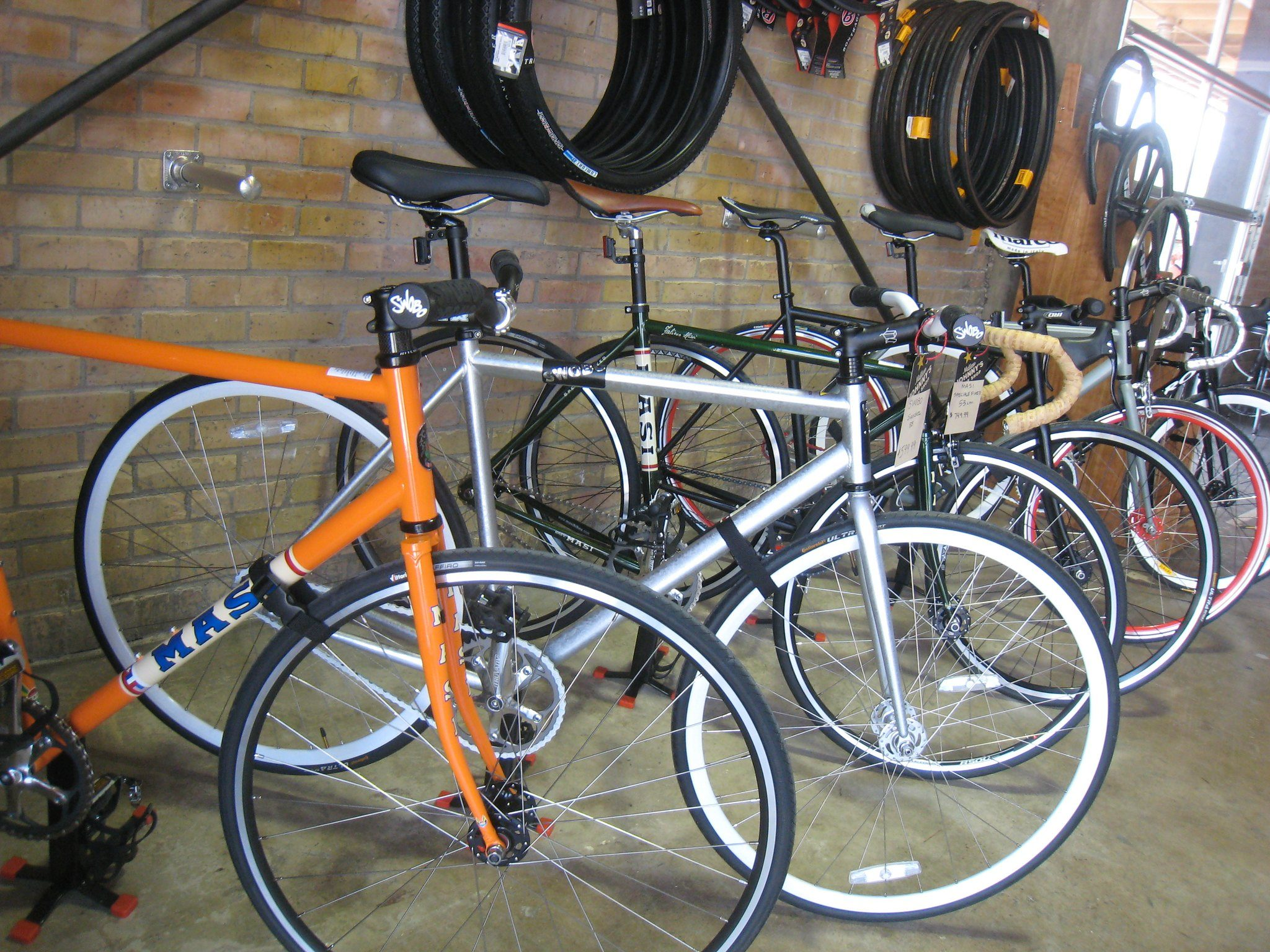 This photo shows a bunch of bikes in a bike shop.