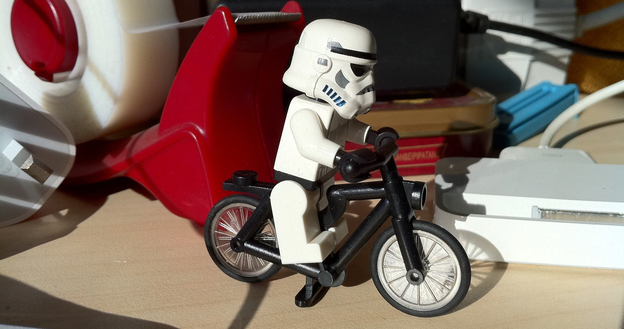 A LEGO Stormtrooper on a bike