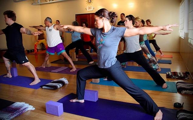 Girl doing yoga warrior pose
