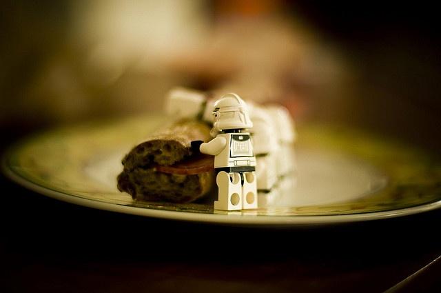 Lego men eating bread