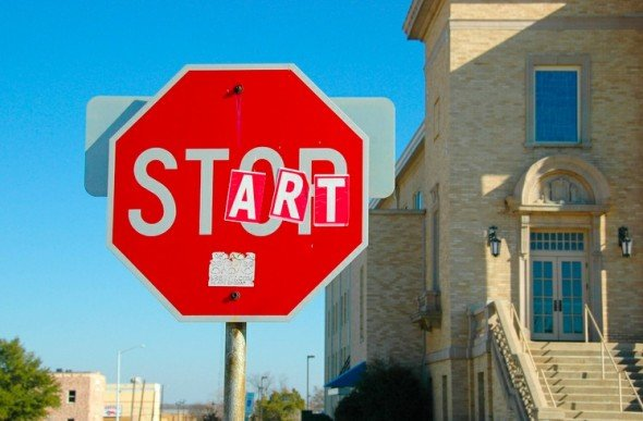 stop sign with OP covered up with ART so it spells START