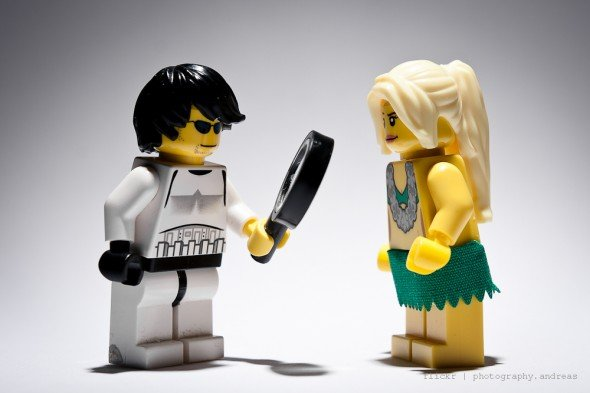 Storm Trooper holds magnifying glass up to girl, begins to build confidence