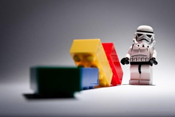Storm Trooper knocks over dominoes to build momentum