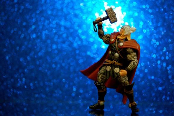 Thor Action Figure doing overhead press