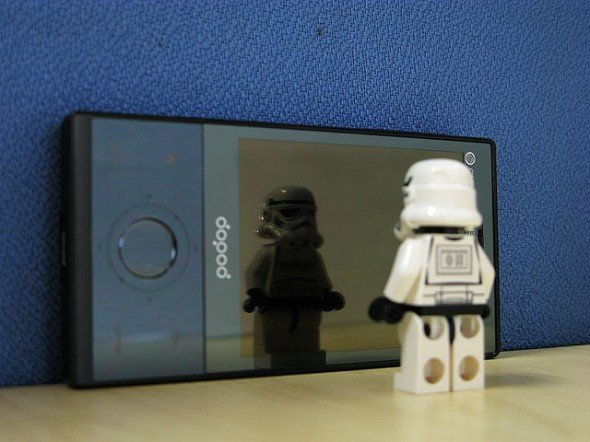 a storm trooper stares at his reflection in the mirror