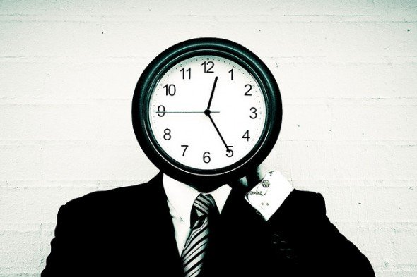 man with clock for face