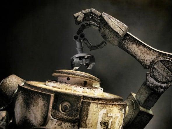Automaton robot holding smaller robot overhead