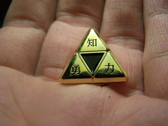 Triforce held in palm