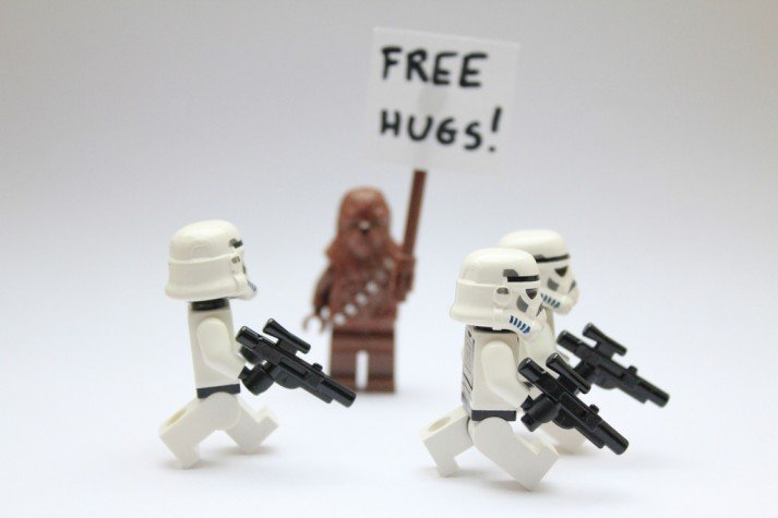 "Chewbacca with a ""free hugs"" sign"