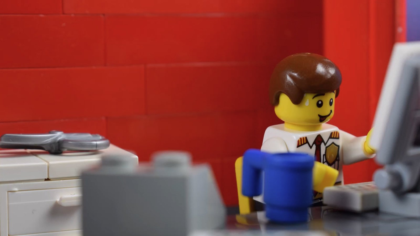 This LEGO is stoked his workplace is set up to his liking.