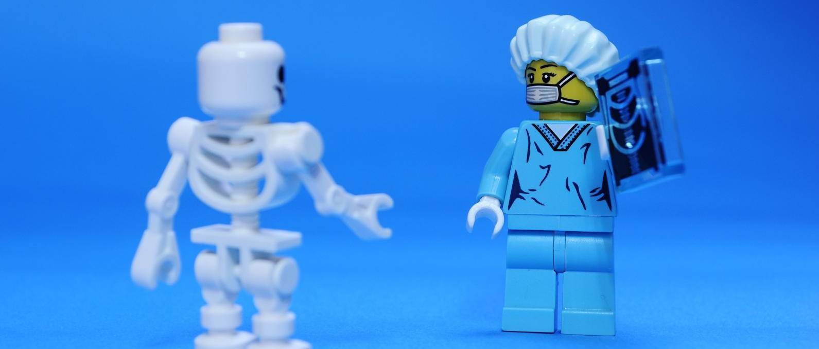 A picture of a doctor and a skeleton, who I don't think can actually get DOMS.