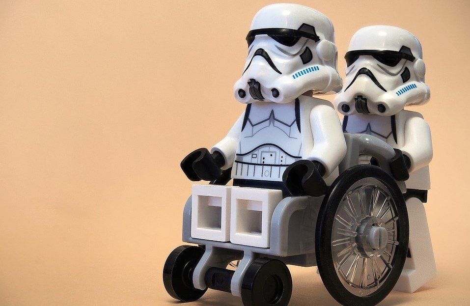 A stormtrooper in a wheelchair, who luckily has a friend to help with his DOMS.