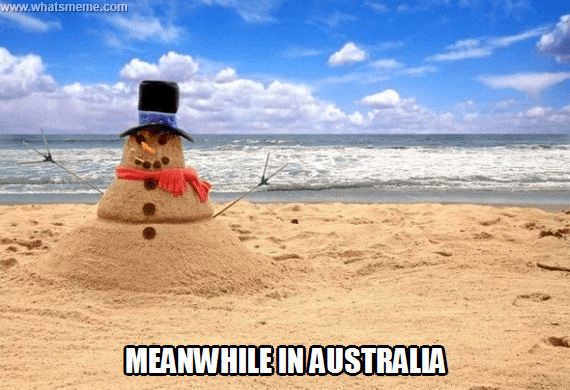 "A picture of a sand ""Snowman"" that says ""meanwhile in Australia"""