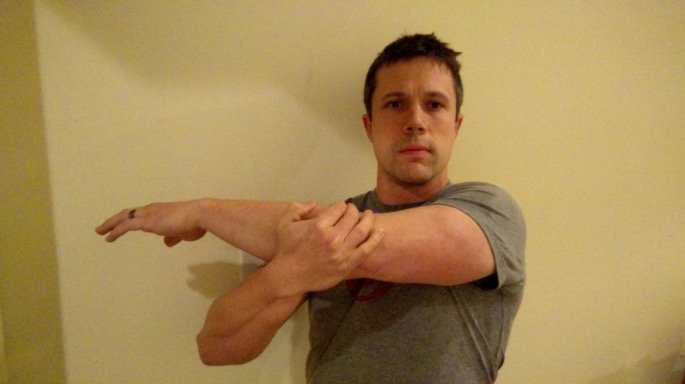 Coach Jim showing you a great stretch for your first day at the gym.