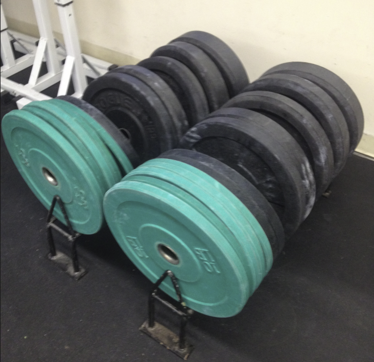 Bumper plates can help you raise your feet for handstand prep.