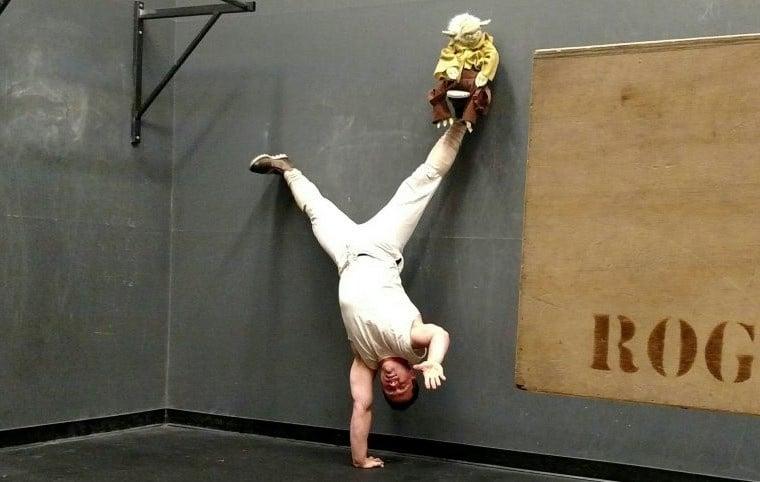 Jim pretending like he's Luke doing a handstand.