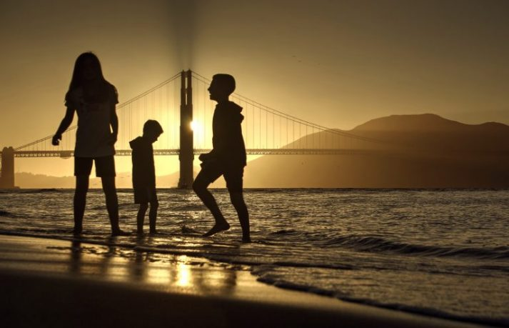 A family playing in the San Fran Bay.