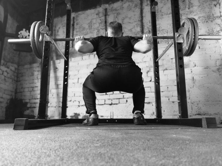 The barbell squat as shown here is a great way to get strong.