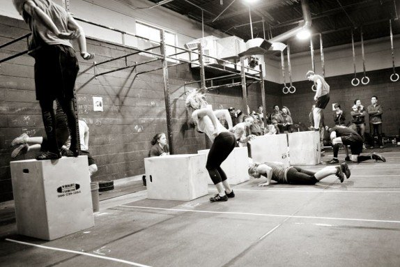 These people are doing box jumps as part of CrossFit.