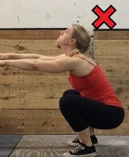 Don't let your head come up like so during your squat movement.