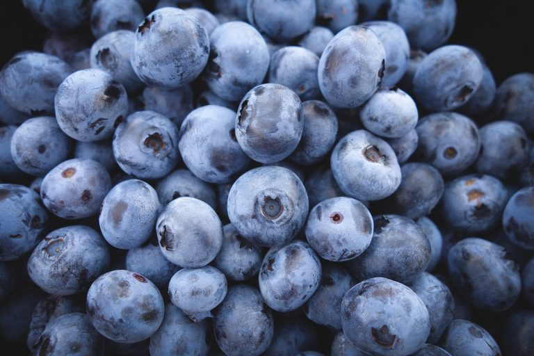 A cup of blueberries (about a fist) is about 85 calories.