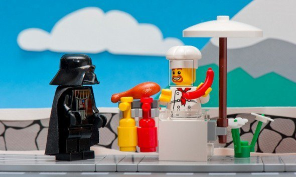 Darth Vader buying a sausage from a street vendor. Paleo approved!