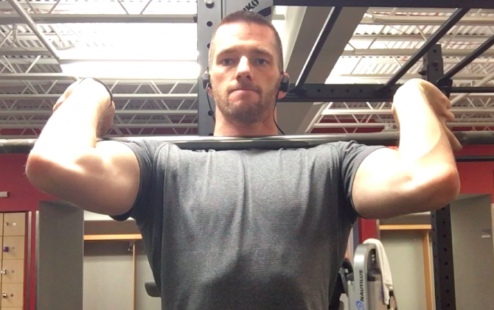 If you have longer than average forearms or poor wrist mobility, grabbing the bar with a wider grip can help