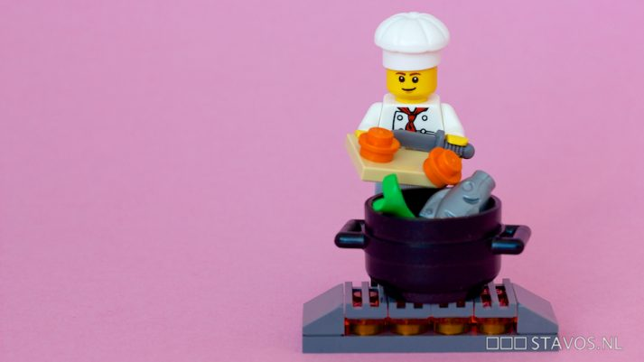 This LEGO is making a tasty meal of fish and veggies, so he can eat healthy.