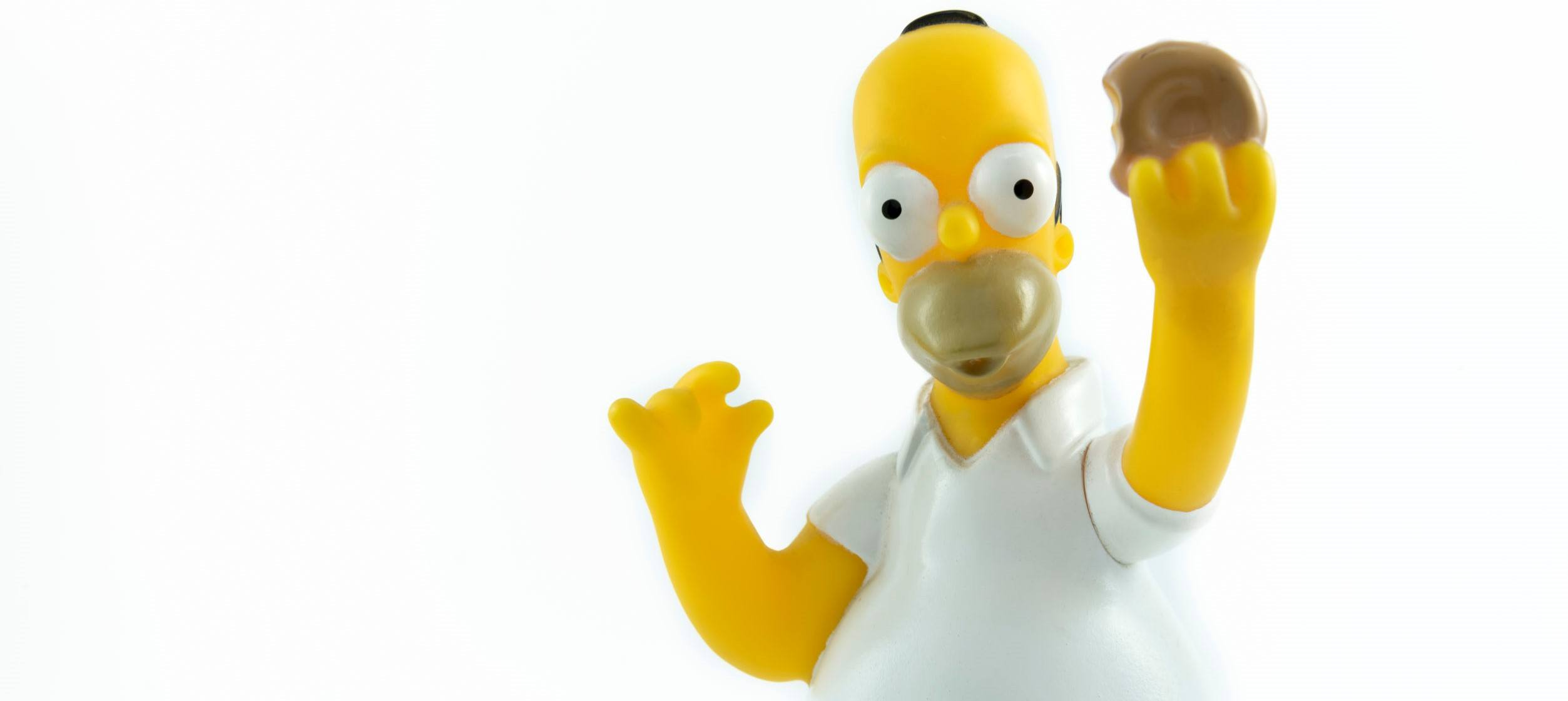 a picture of Homer Simpson with Donut