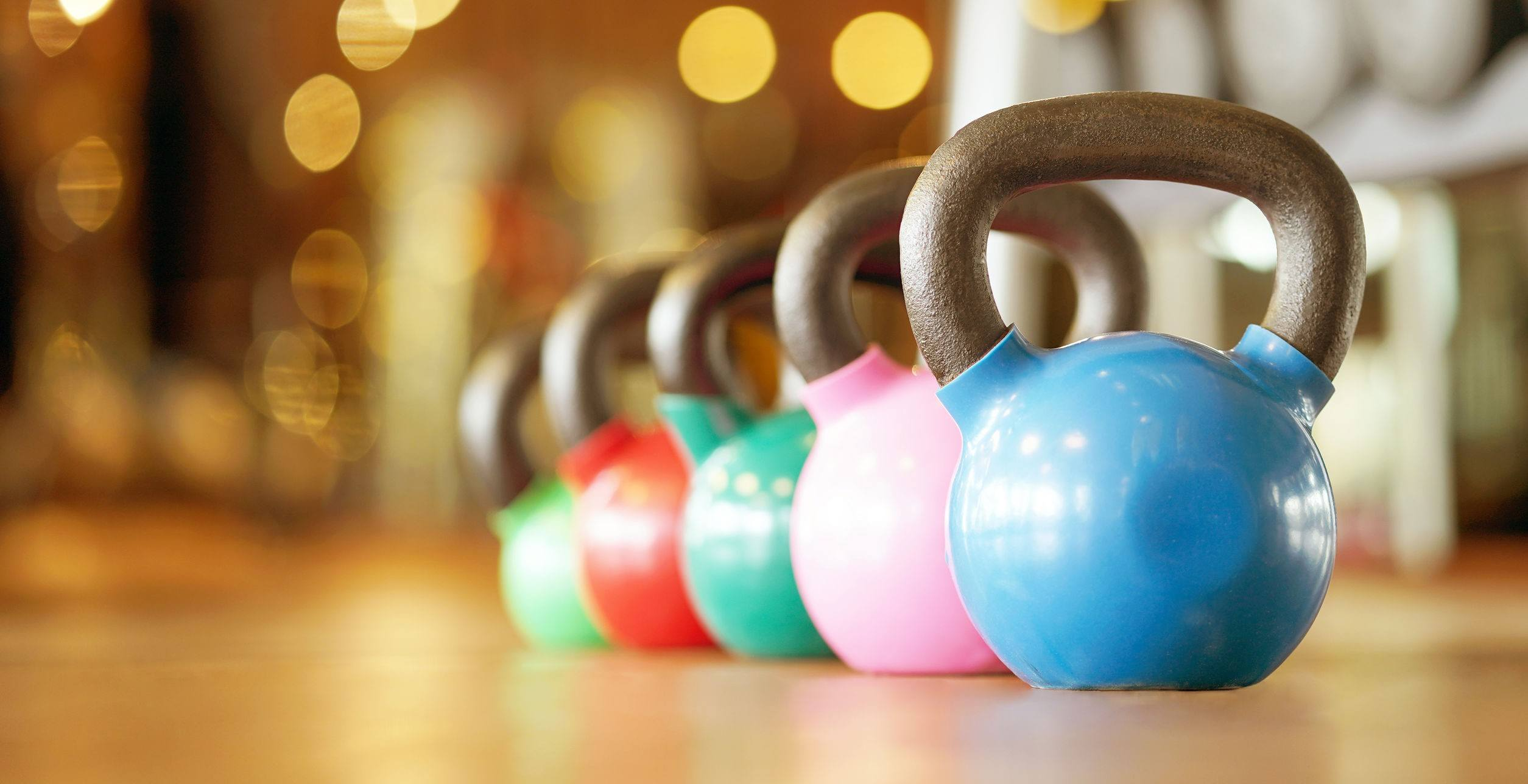 Colorful kettlebells in gym