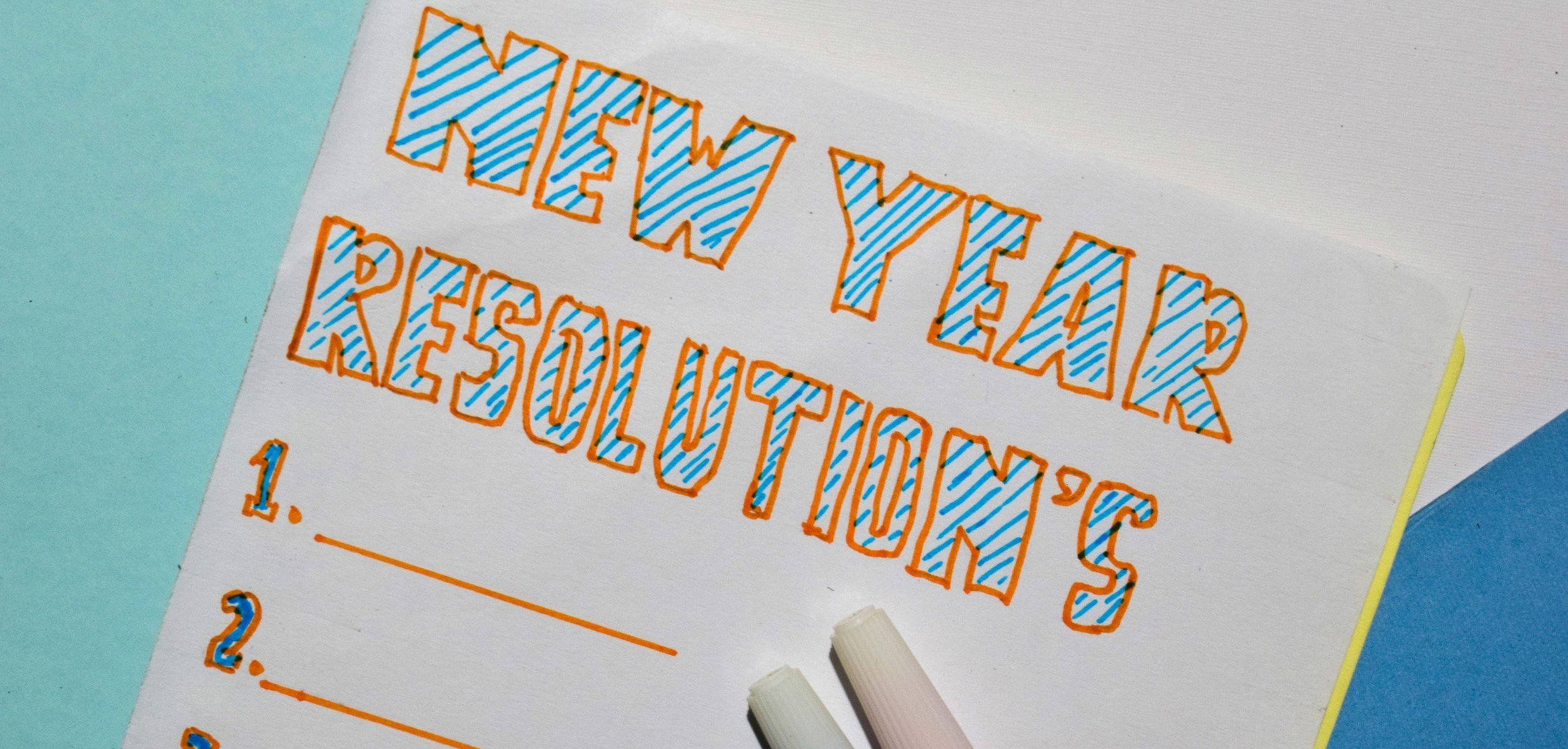 Top view New Year Resolutions text list with marker and eyeglasses for business presentation mock up for adding your list