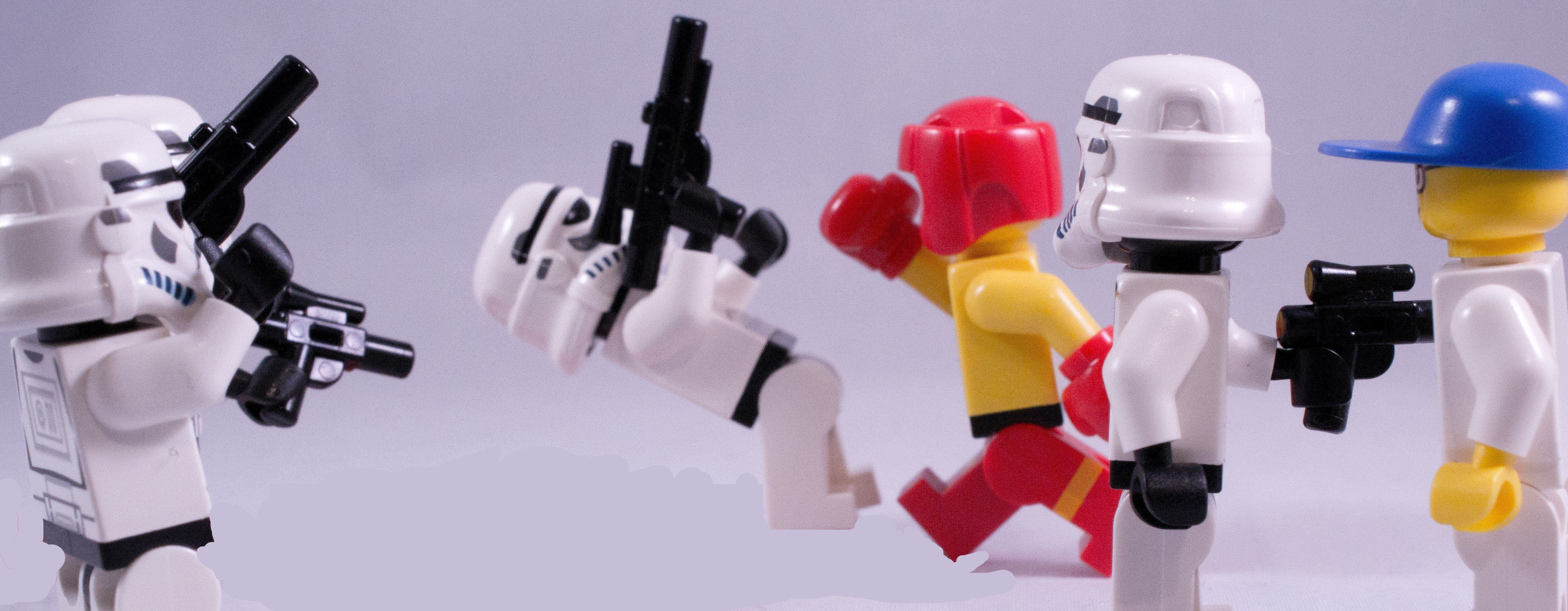 A LEGO boxer, who clearly jumps rope, fighting some stormtroopers.