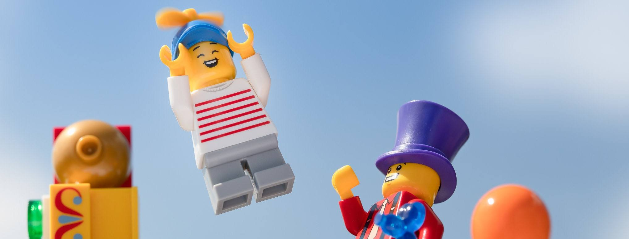 Two LEGOs are together, one flying away. Is the other flexible enough to catch him?