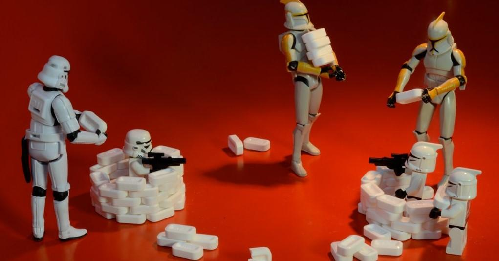 This picture some Stormtroopers and mini-stormtroopers play fighting.