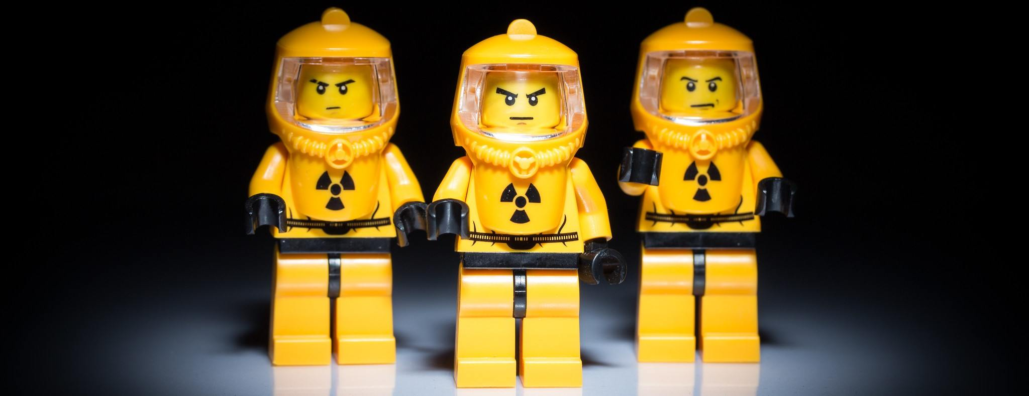 These three LEGOs in Hazmat suits are likely on their way to the gym.