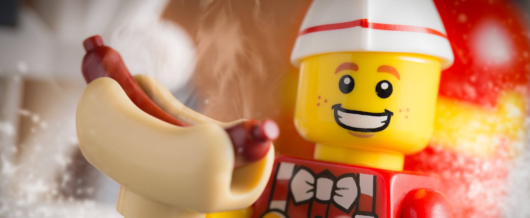 A LEGO holding a hot dog, which may help with his protein goals.