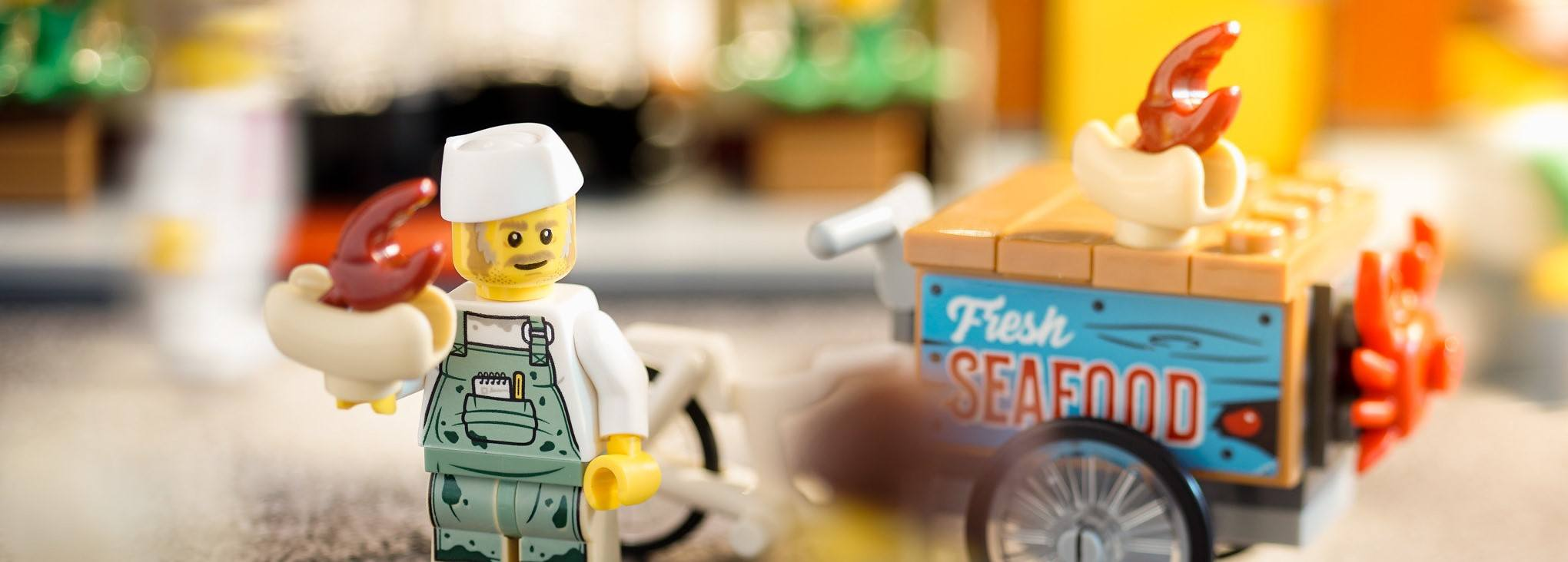 A LEGO holding some seafood, which looks like a big portion size.
