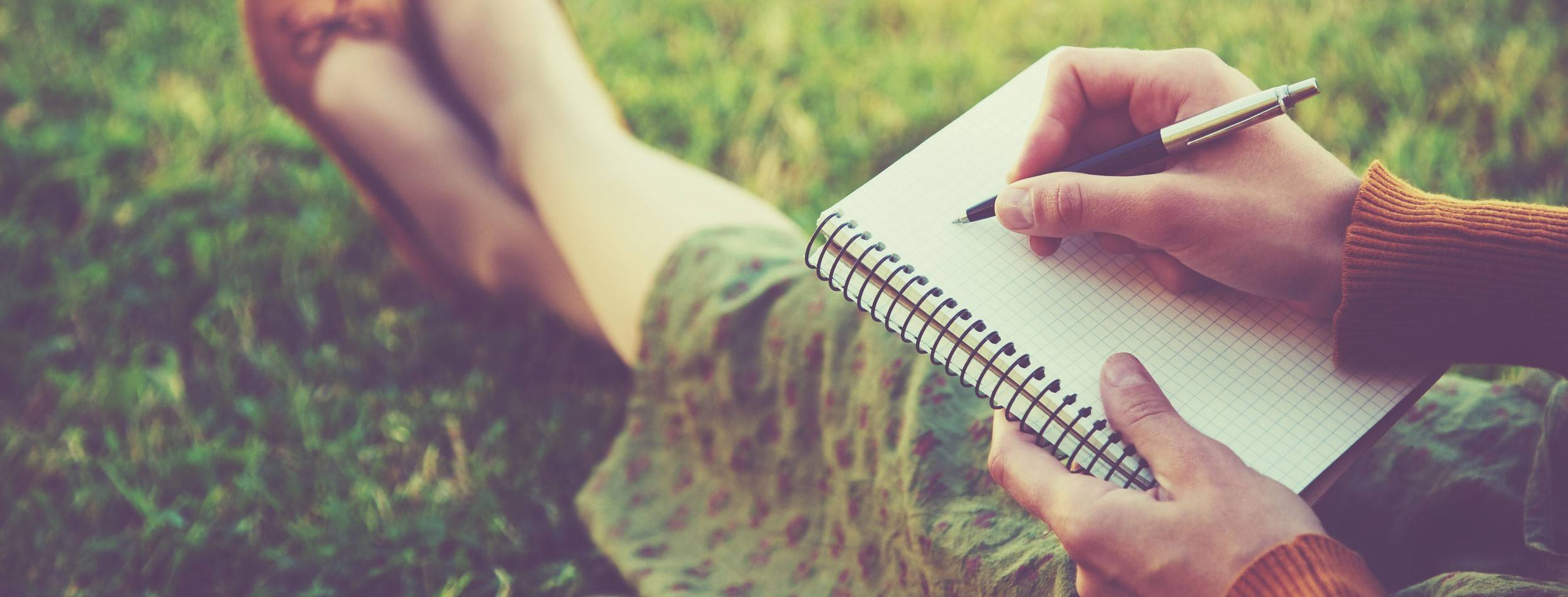 A photo of someone journaling their fitness progress.