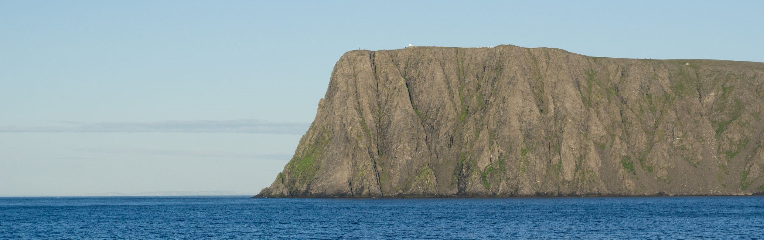 orth Cape with a steep cliff and a large flat plateau is in the Barents Sea.