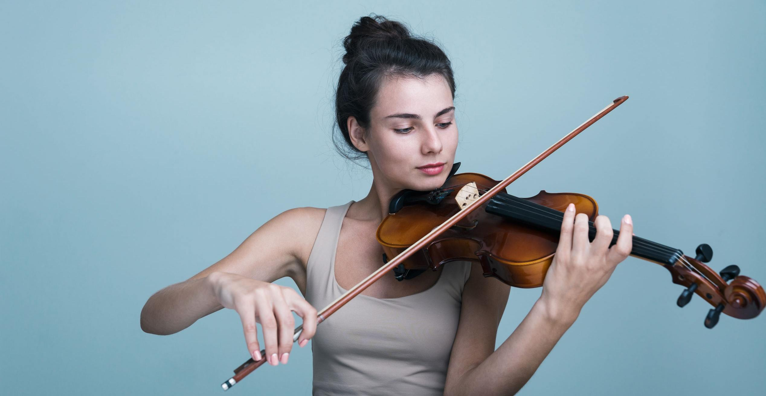 A pic of a violinist, who'd feel like an imposter if she had teammates.