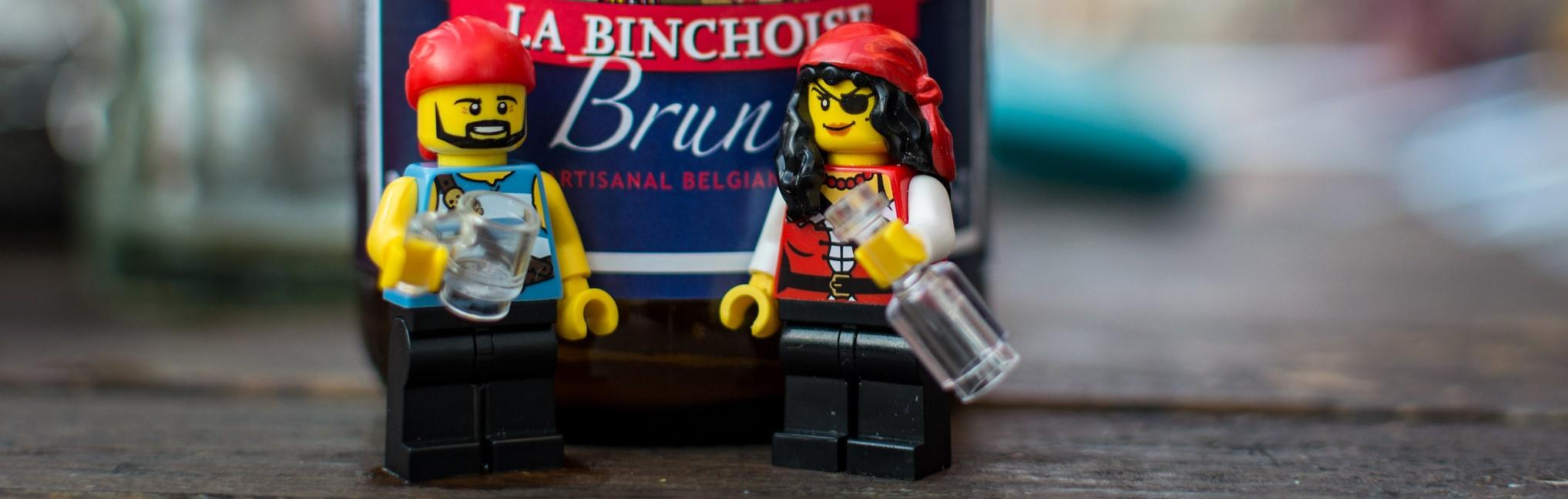 A picture of two LEGOs drinking in front of a beer bottle...in February.