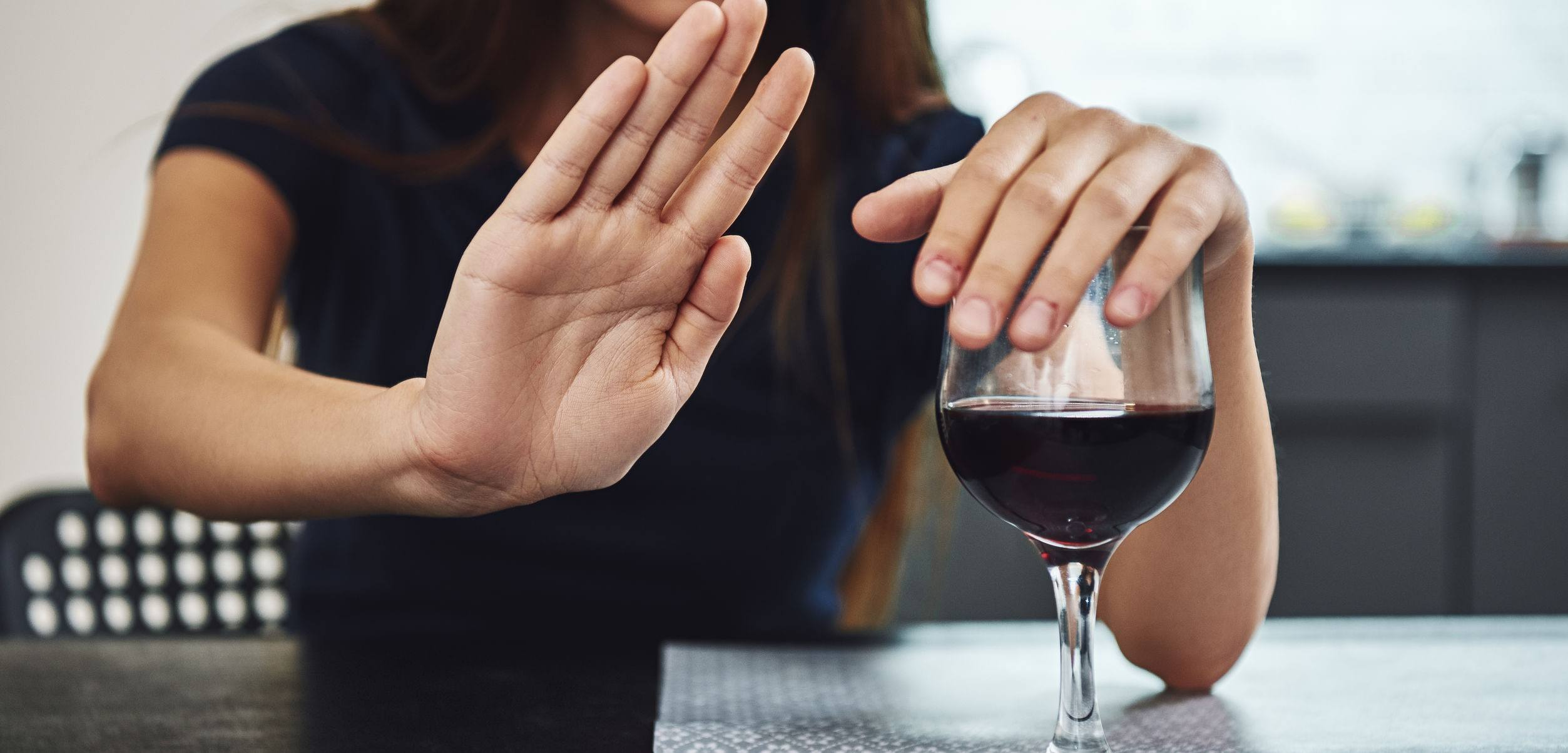 A person saying no to wine.