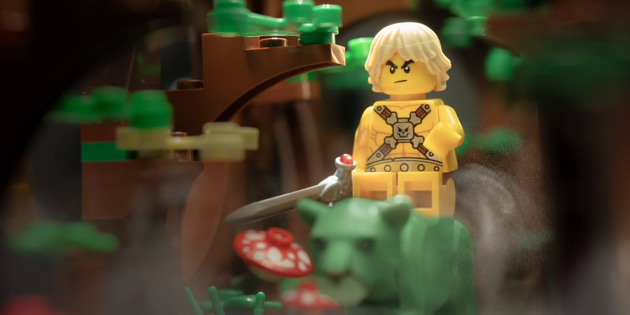 a photo of a LEGO riding a tiger, He-Man style