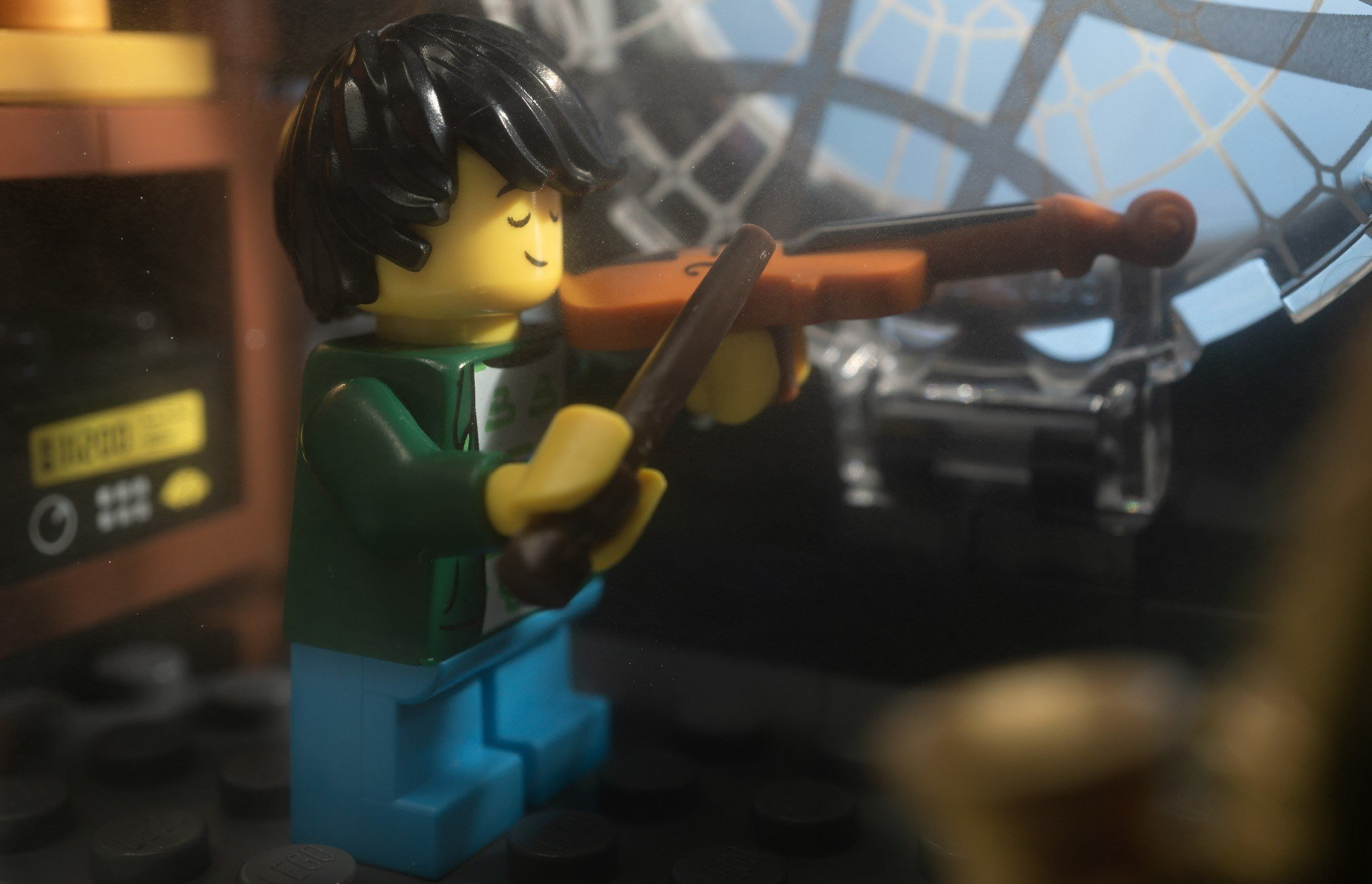 A LEGO playing the violin.