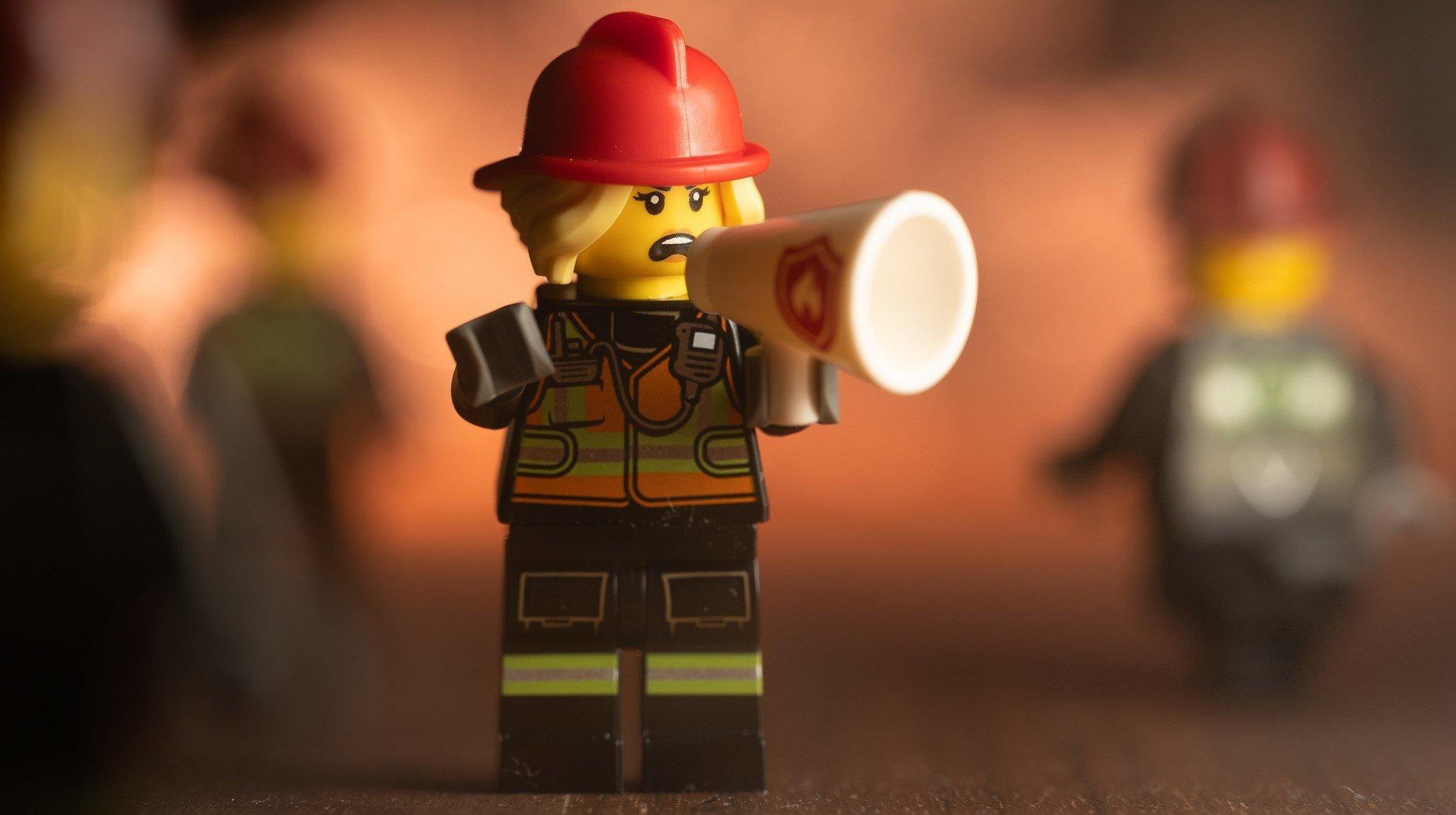 A LEGO Firefighter on a bullhorn.