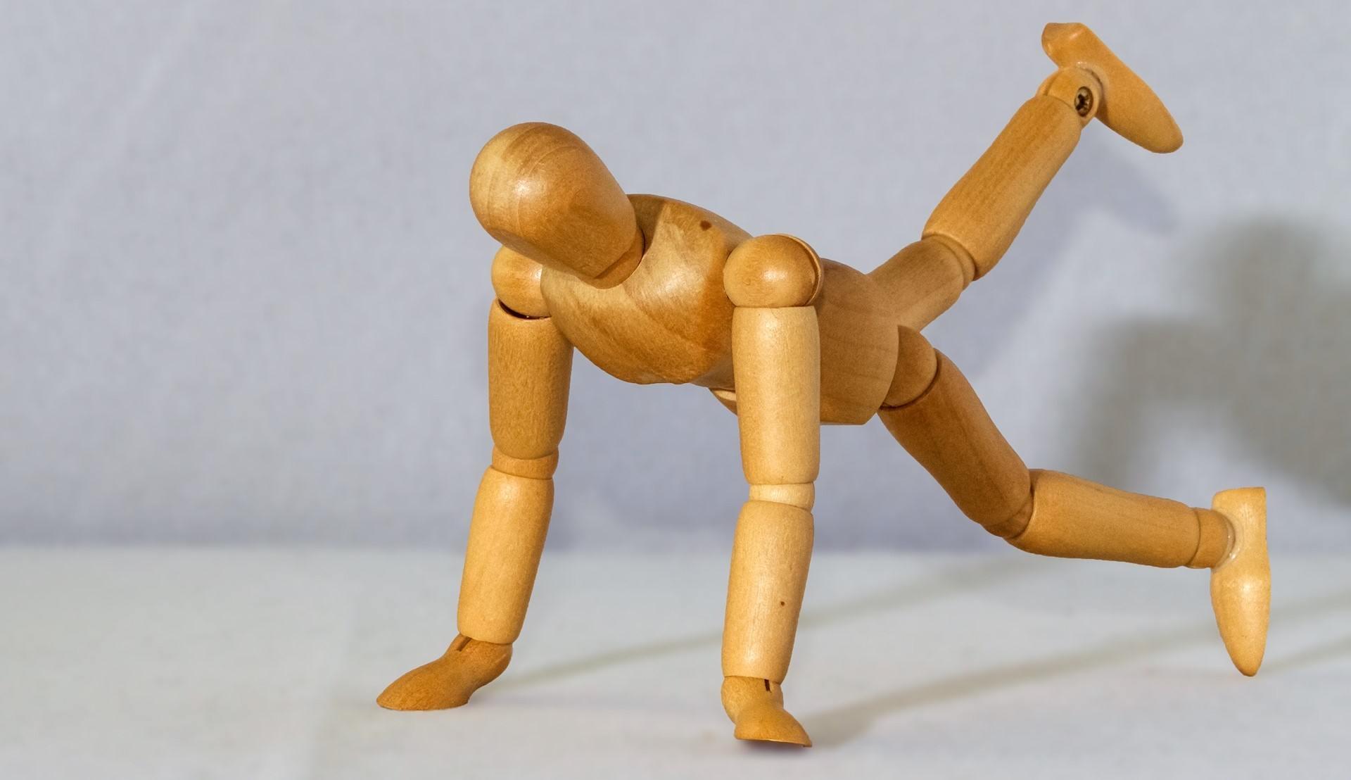 A figure doing a push-up