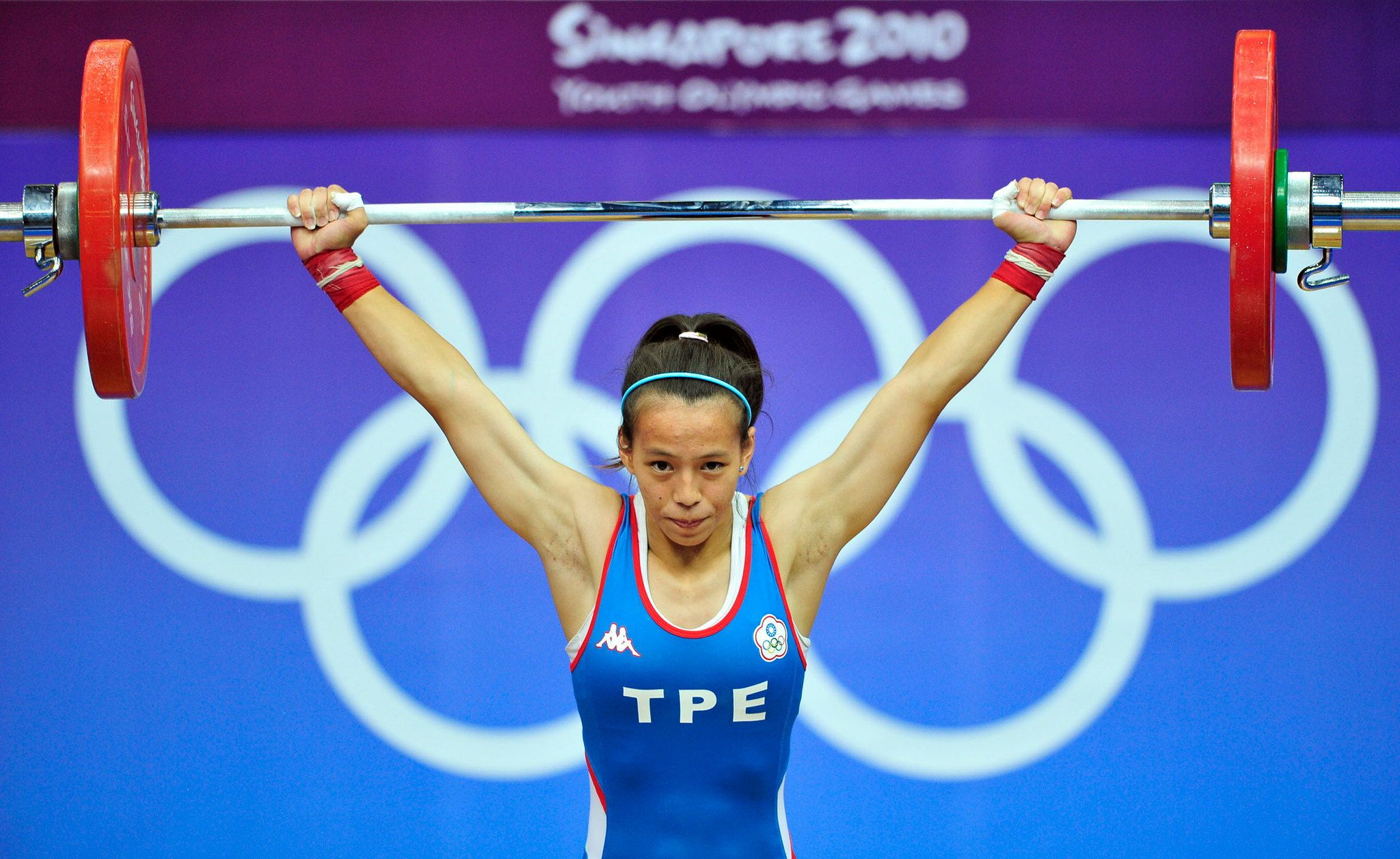 A woman doing an Olympic lift