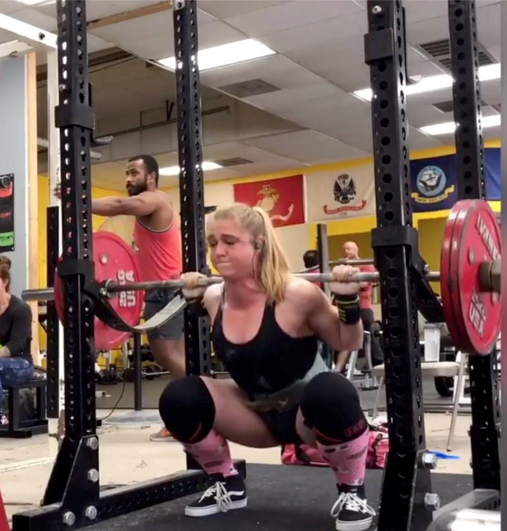 Staci doing a back squat