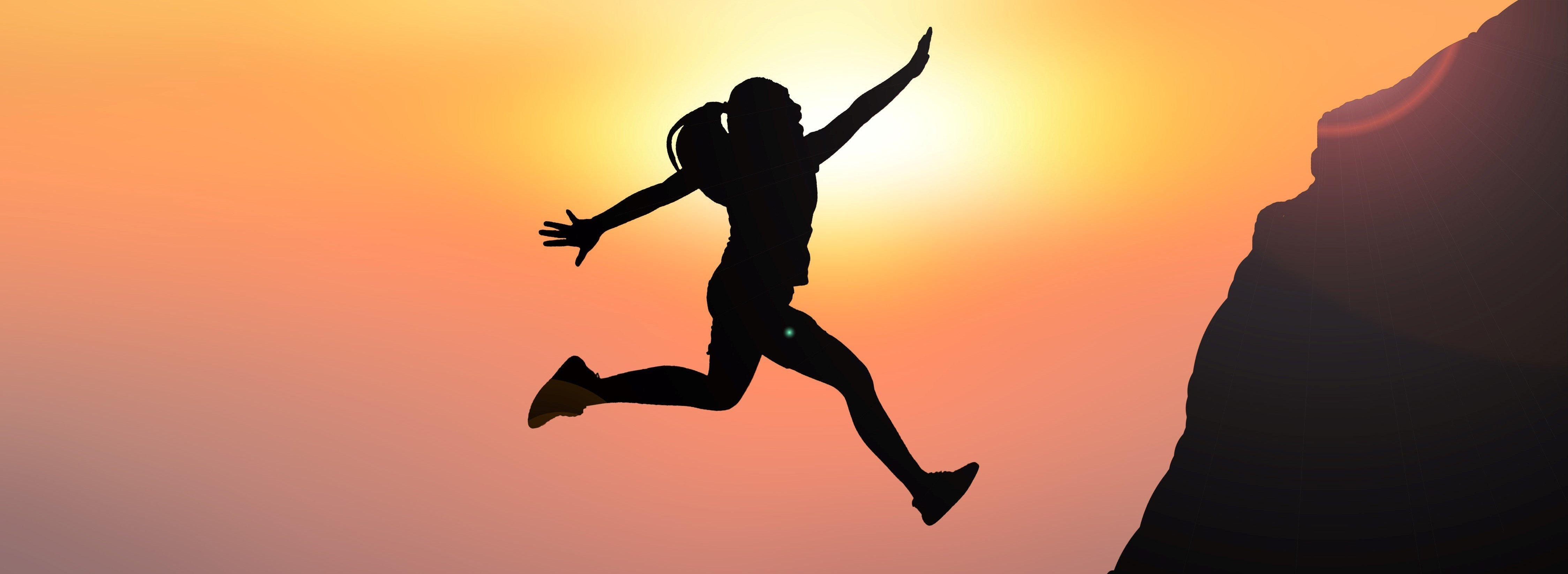 Silhouette women jumping